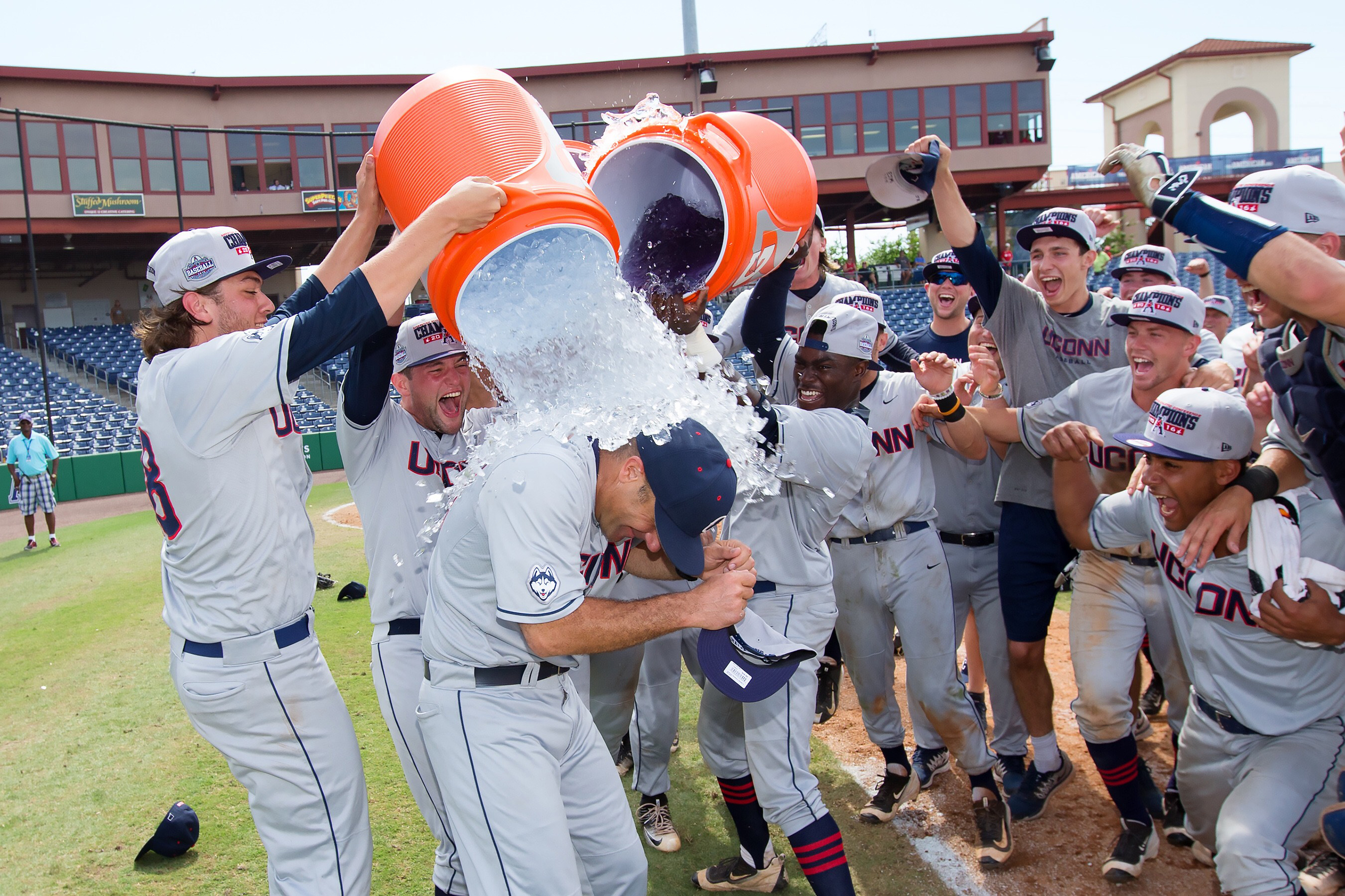 Penders led the Huskies to their first-ever American Athletic Conference crown last season. Here he is seen doused with ice and Gatorade by his team.