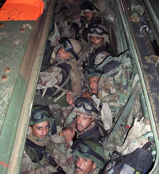 Soldiers from Fifth Battalion are packed into a Marine Corps amphibious assault vehicle minutes before the breach of Fallujah in November 2004.