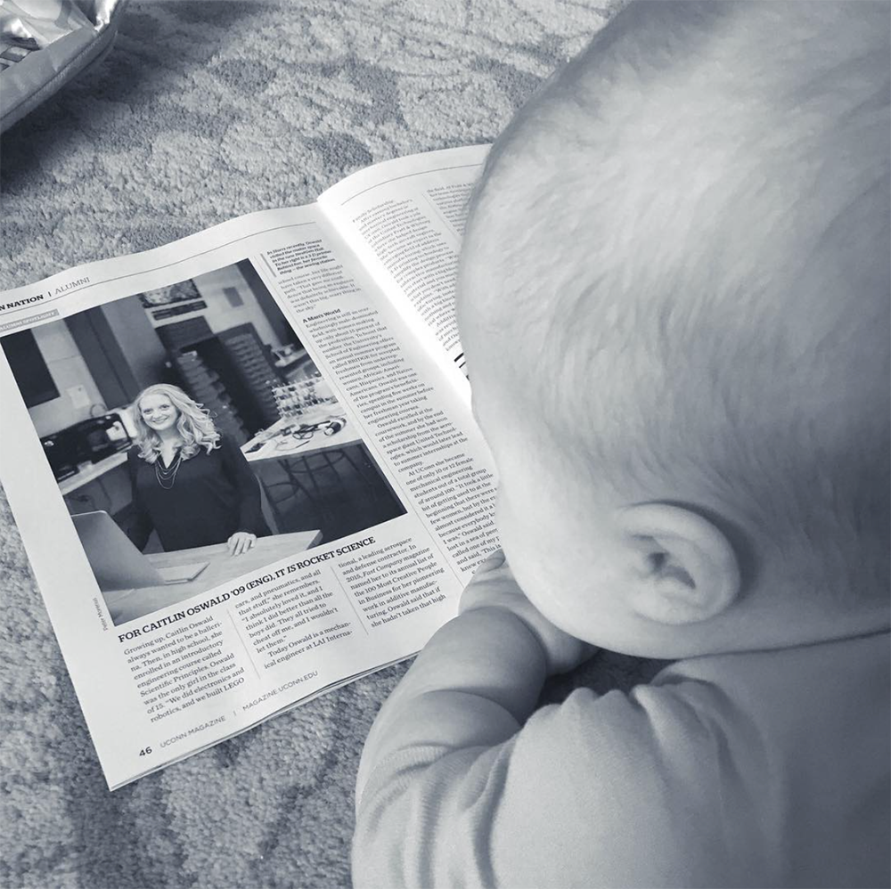 Baby-Q reading up on his mama in UConn Magazine
