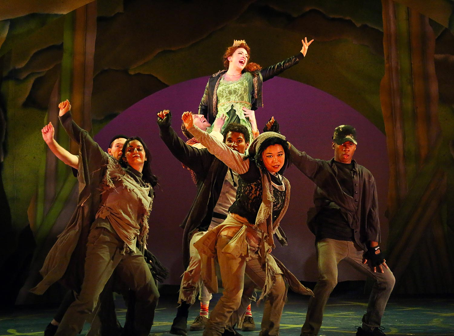Actors do a choreographed dance with Princess Fiona on top of a human pyramid