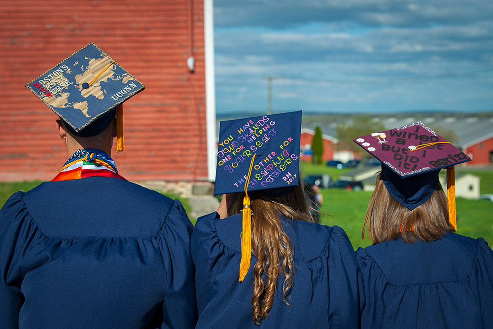 3 grads model their decorated caps