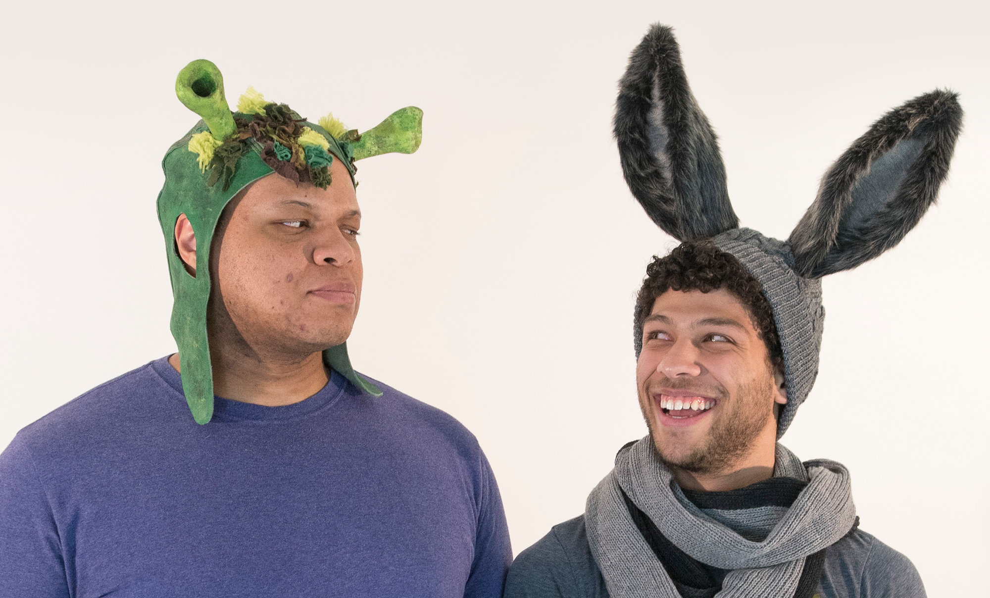 """During costume tests for CRT's """"Shrek the Musical,"""" which ran in April, Broadway's Will Mann is fitted for his Shrek ears with Donkey aka Scott Redmond '17 (SFA)."""