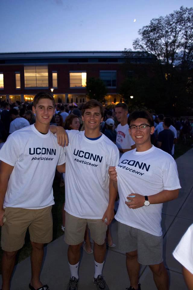 3 young men wear #oneUConn shirts