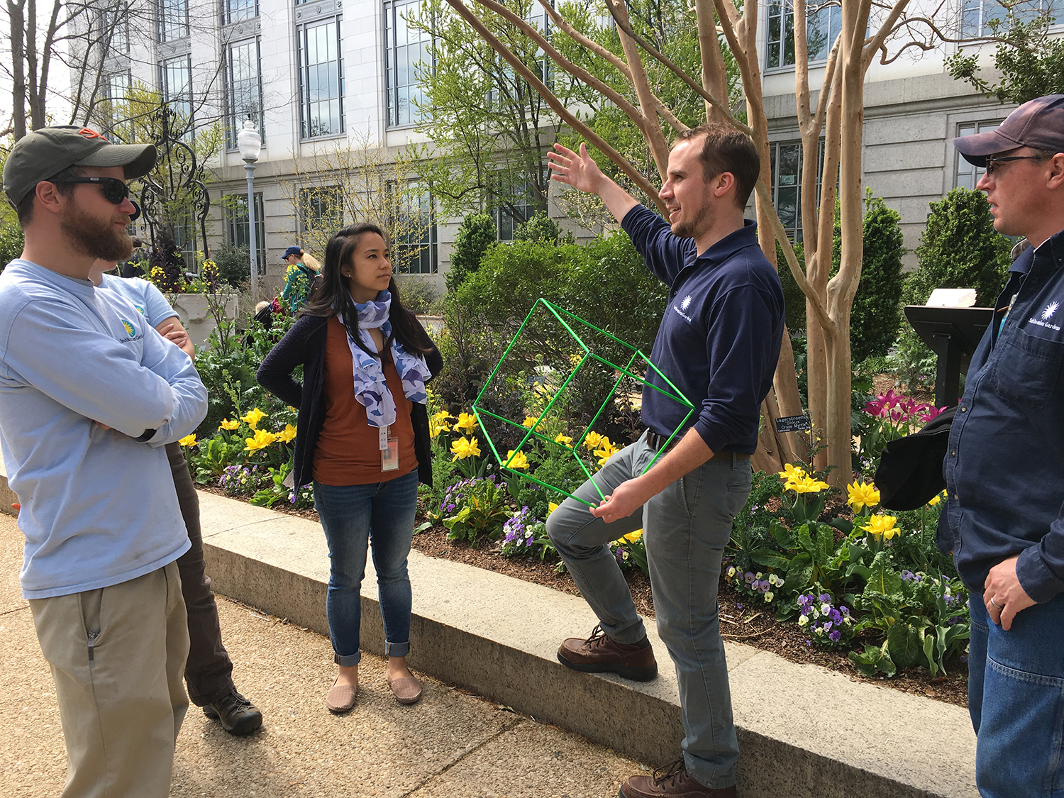James meeting with staff of Smithsonian Gardens and the National Museum of Natural History to discuss an upcoming exhibit in the Pollinator Garden on Biocubes—the life in a cubic foot of soil or water over one day. Close