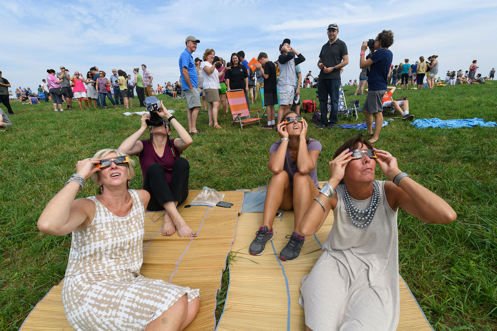 students and faculty view the Aug. 21, 2017's Solar eclipse on UConn Storrs' Horsebarn Hill