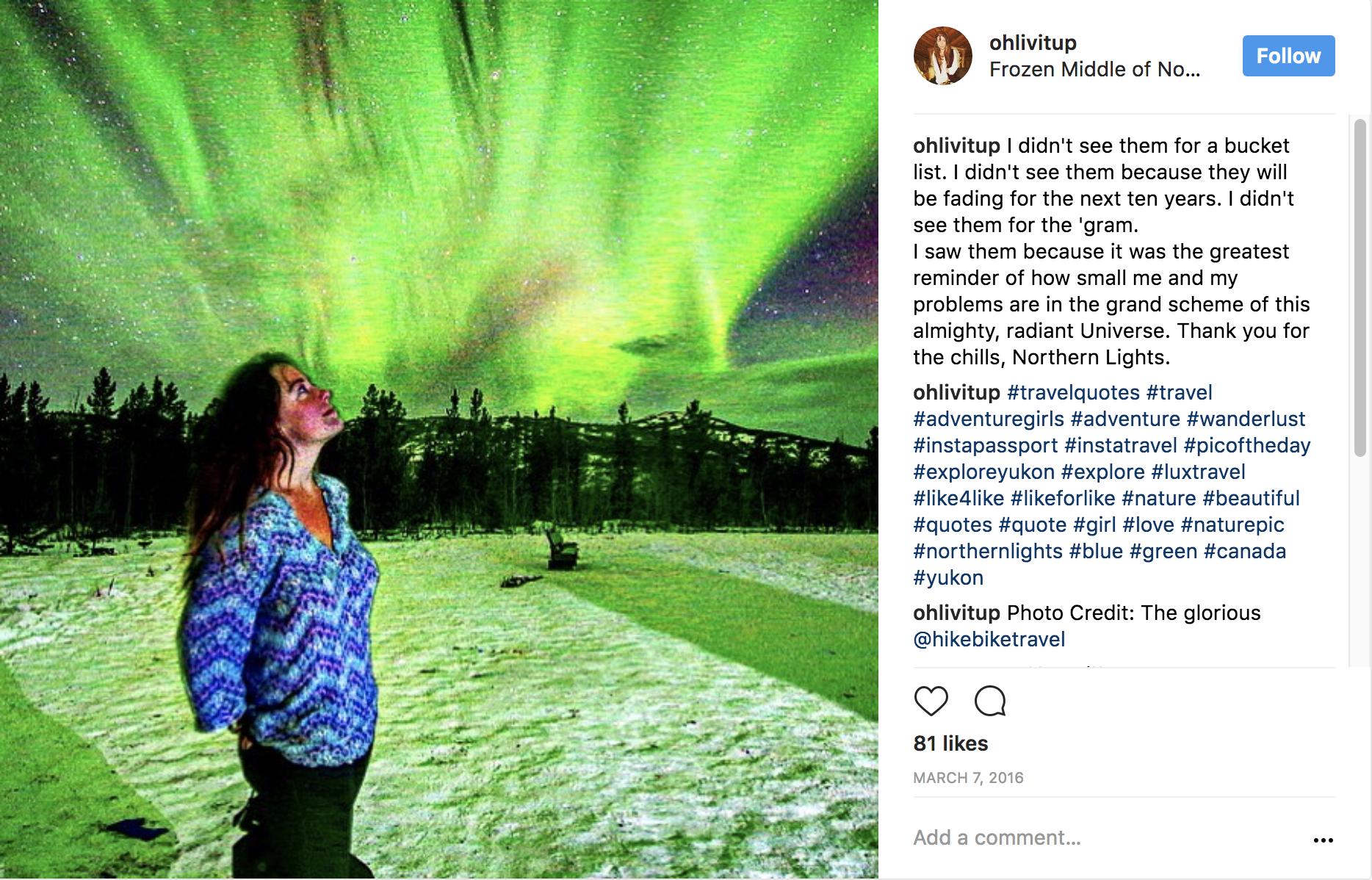 standing under the gleaming Aurora Borealis in Yukon Territory.