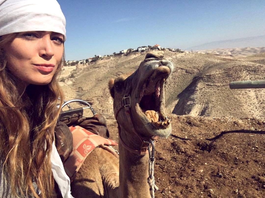 selfie with Olivia Balsinger and a smiling camel
