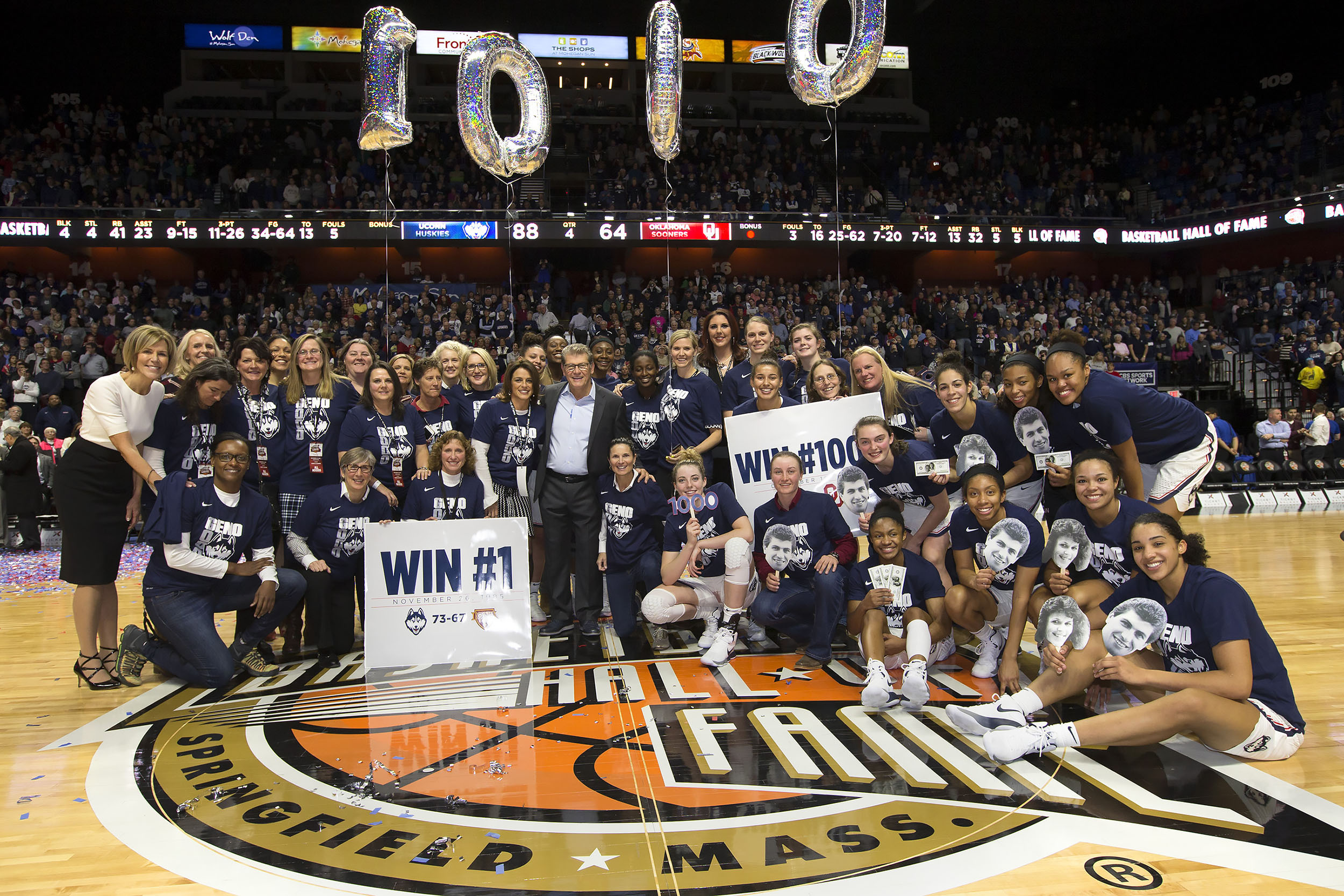Members of the women's basketball team past and present celebrate the 1,000th win for Geno Auriemma and Chris Dailey at the Mohegan Sun Arena on Dec. 19, 2017