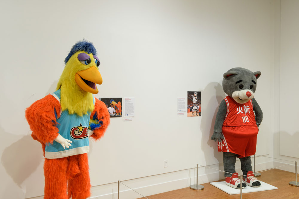 The Famous San Diego Chicken, left, and Clutch the Rockets Bear wearing a Chinese language jersey on display at
