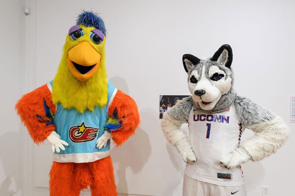 "Jonathan the Husky, UConn's current mascot, right, poses with the Famous San Diego Chicken at ""Mascots! Mask Performance in the 21st Century"" at the Ballard Institute and Museum of Puppetry"