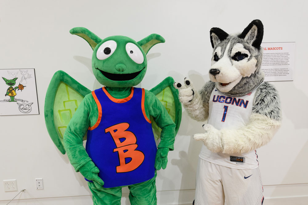"Jonathan the Husky, UConn's current mascot, right, poses with ESPN's mascot Buster Brackets at ""Mascots! Mask Performance in the 21st Century"" at the Ballard Institute and Museum of Puppetry"