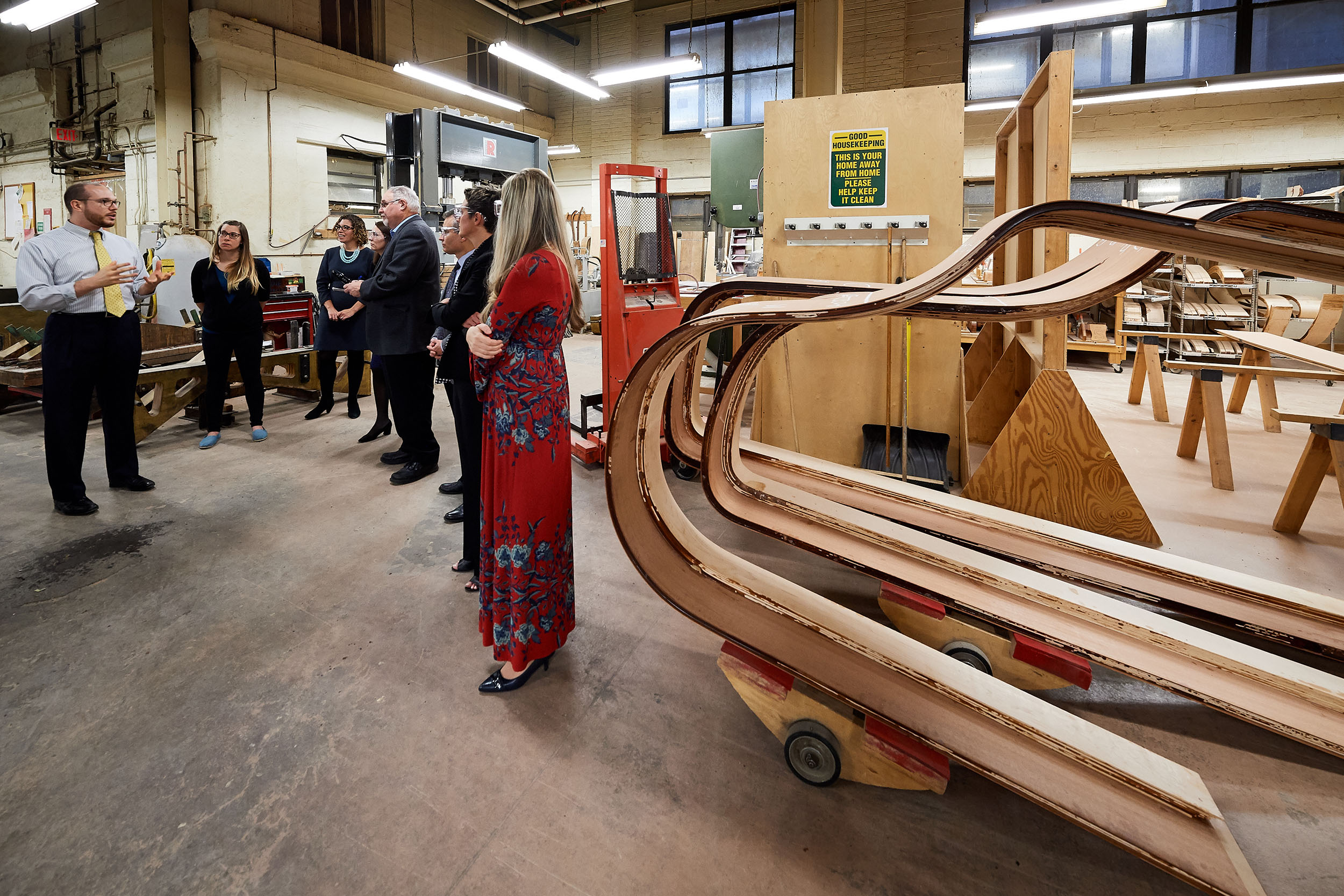 Logan Thompson, selection room manager, explains the process for forming the rim of a Steinway & Sons piano during a factory tour