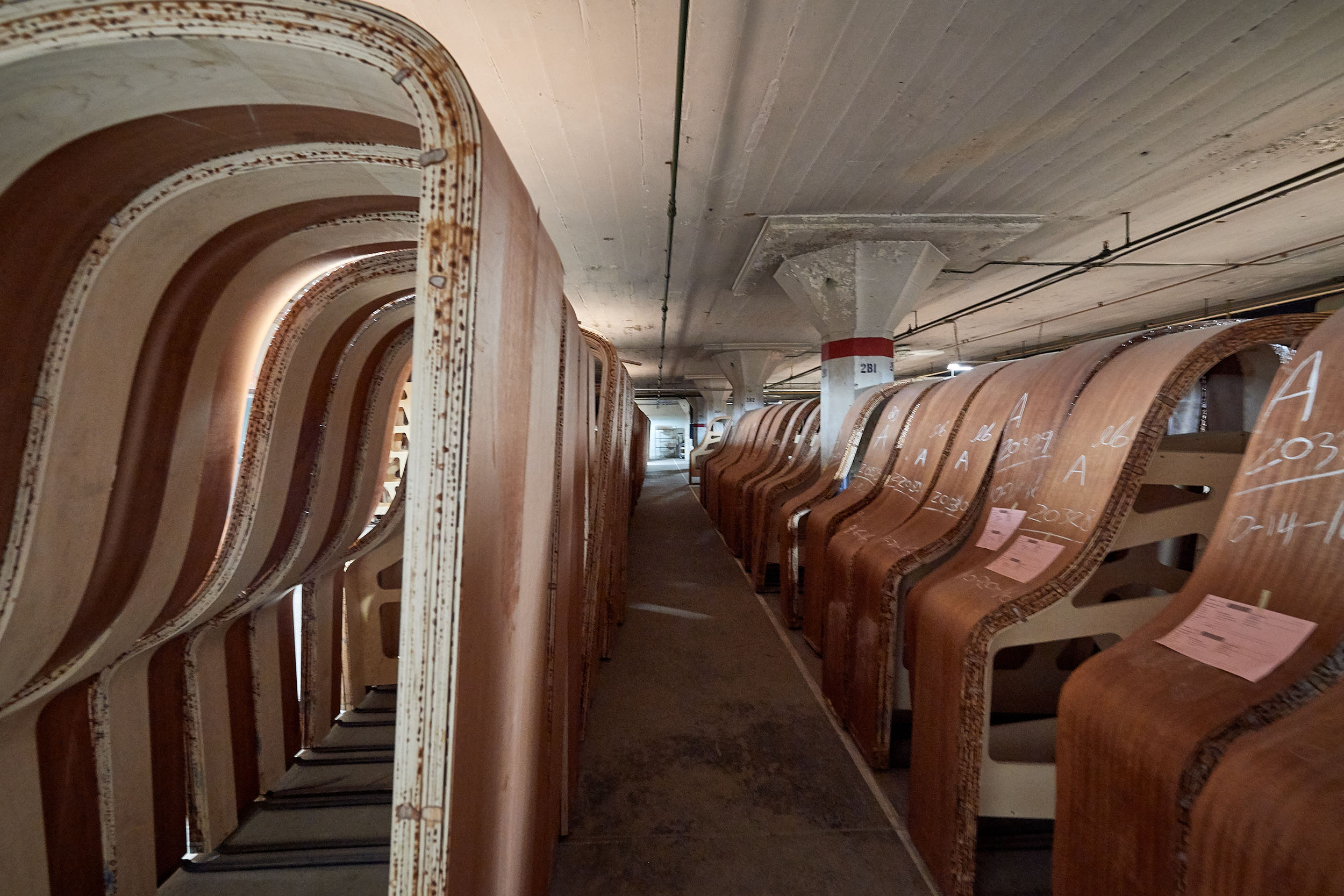 Piano rims cure in a storage room at the Steinway & Sons factory