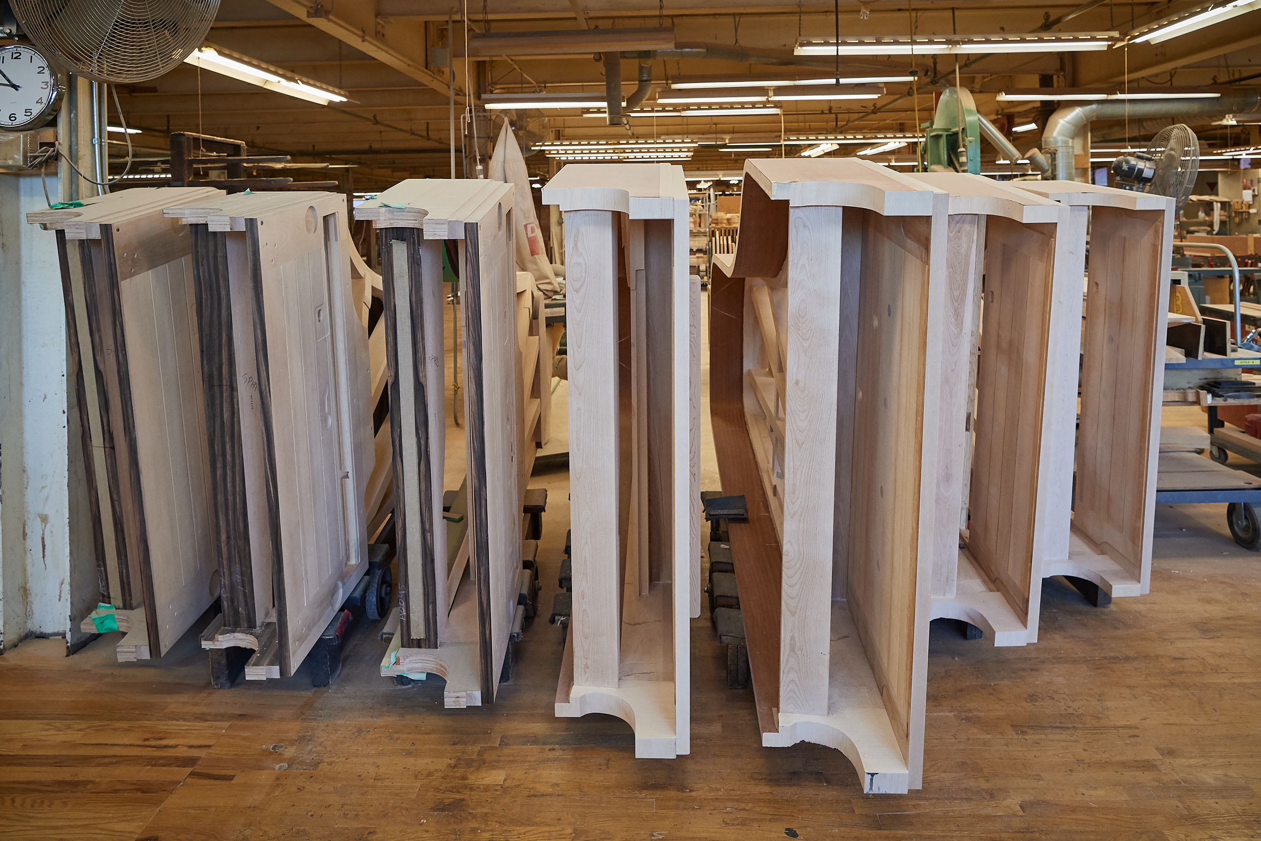 Pianos wait for laminate to be applied