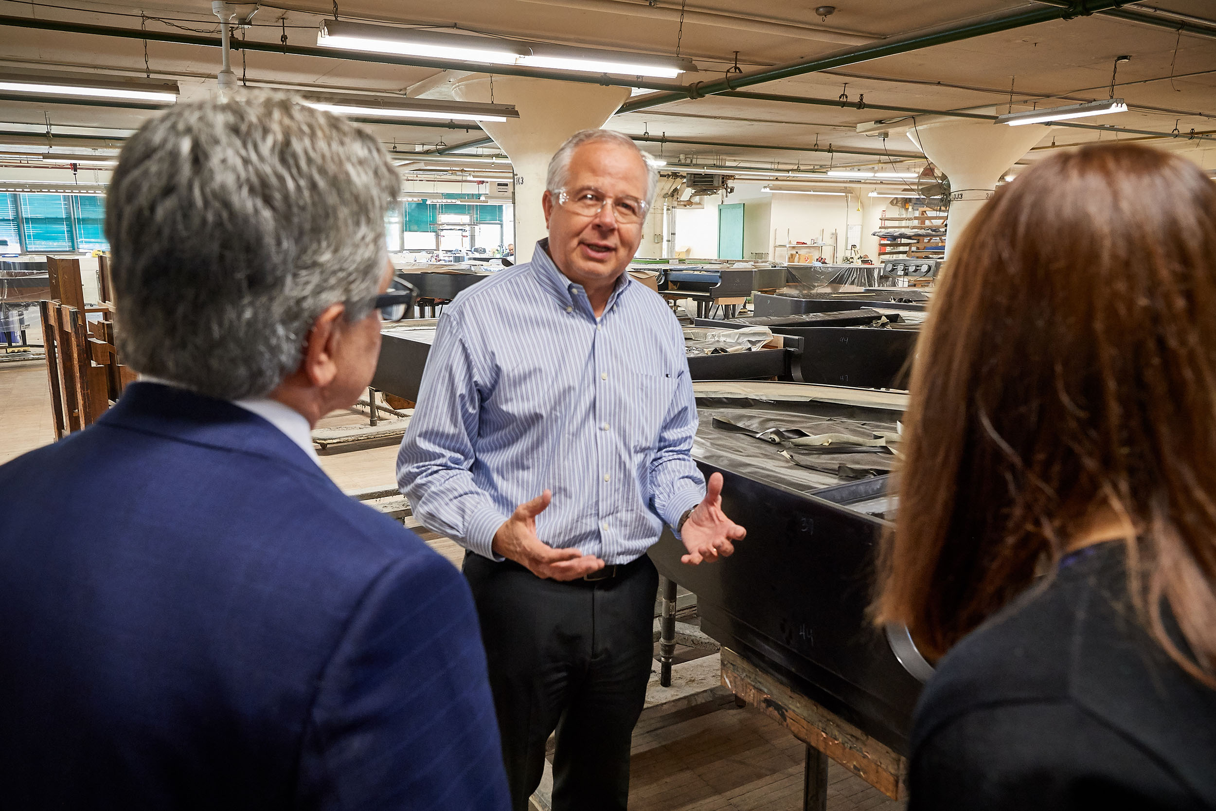 Andrew Horbachevsky '80 (ENG), vice president of manufacturing tells a trou group about the training of Steinway & Sons employees at the factory on Oct. 18, 2017.