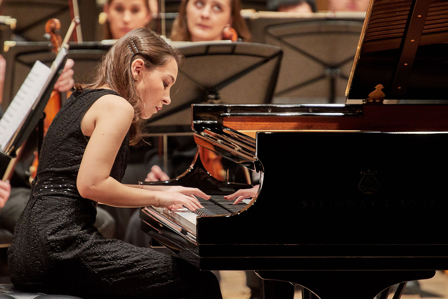 Olga Radovic, a graduate student, plays the inaugural performance on the university's new Steinway model D concert grand piano while performing with the UConn Symphony Orchestra at von der Mehden Recital Hall on Dec. 7, 2017.
