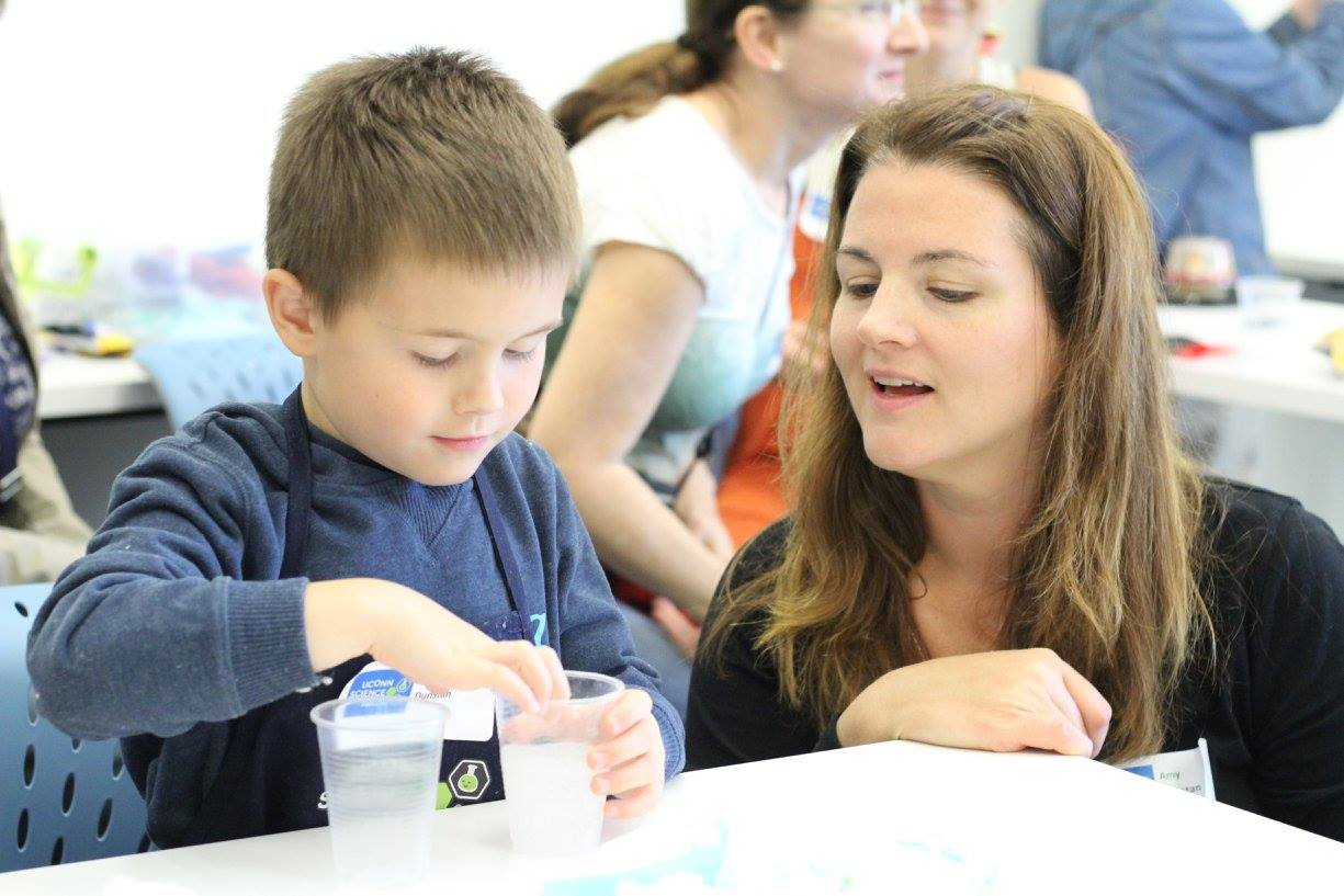mother and son do science experiments at UConn's Science Salon Jr. Event