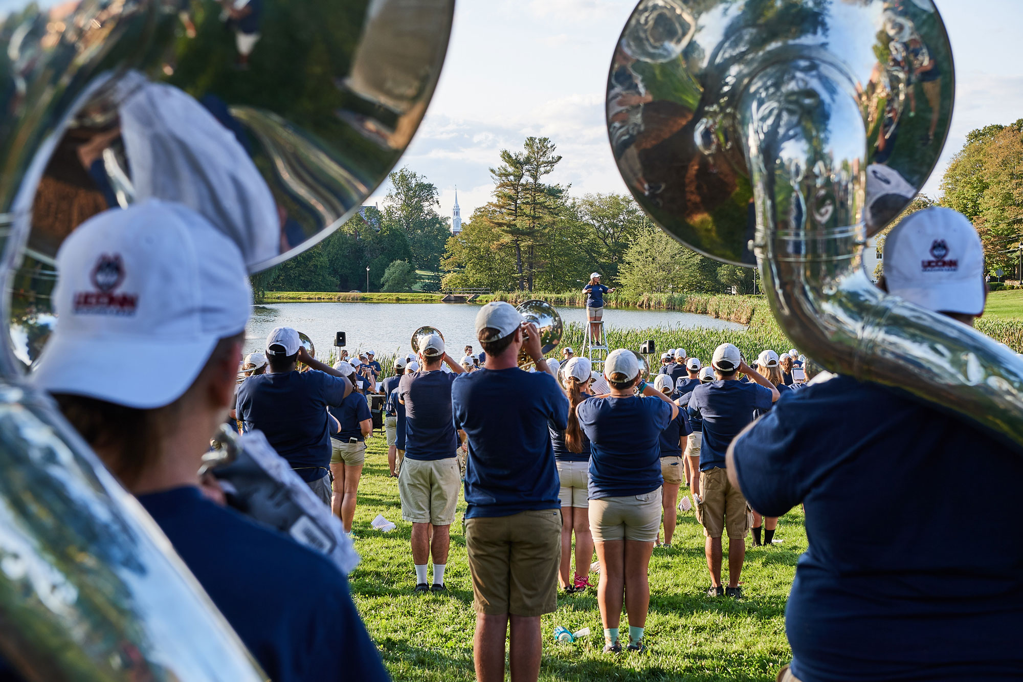 The UConn Marching Band performs along Mirror Lake