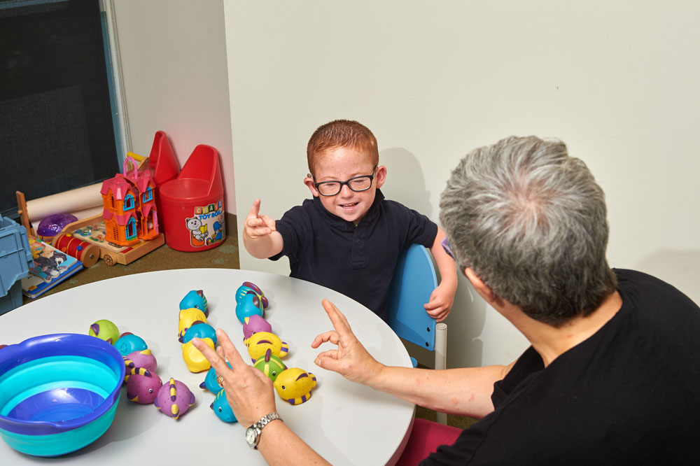 Marie Coppola tests children at the Bousfield Psychology Building
