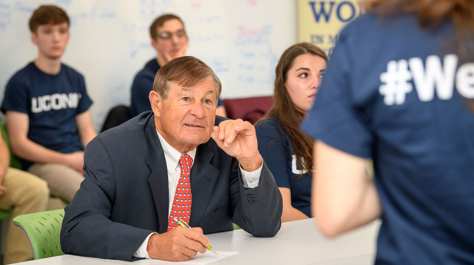 Peter J. Werth listens to student presentations