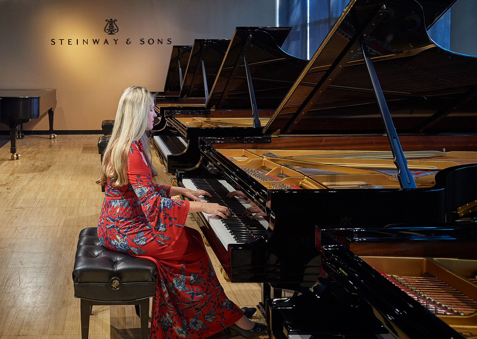 Assistant music professor Angelina Gadeliya tests grand pianos at the Steinway & Sons factory in Queens, New York