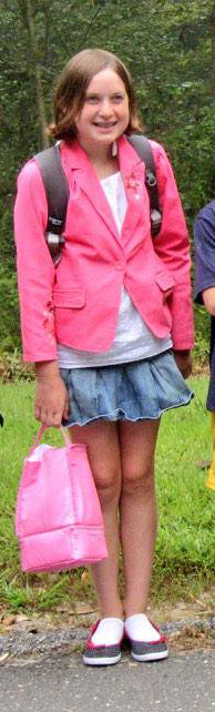 Elizabeth Charash in 4th grade with her pink blazer