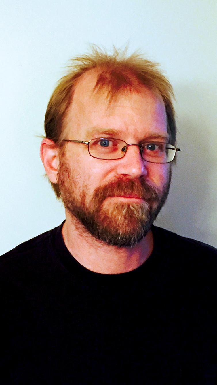 bearded male in black tee