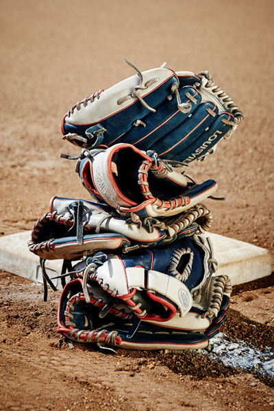 Stack of softball gloves on the field