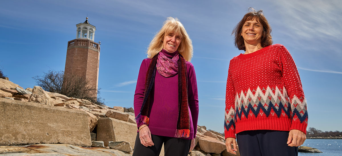 Ann Bucklin, left, and Tracy Romano stand near the Avery Point Lighthouse
