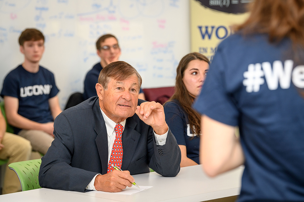 Peter J. Werth listens to a presentation during an entrepreneurship and innovation huddle