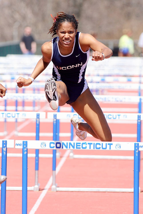Phylicia George running hurdles at UConn