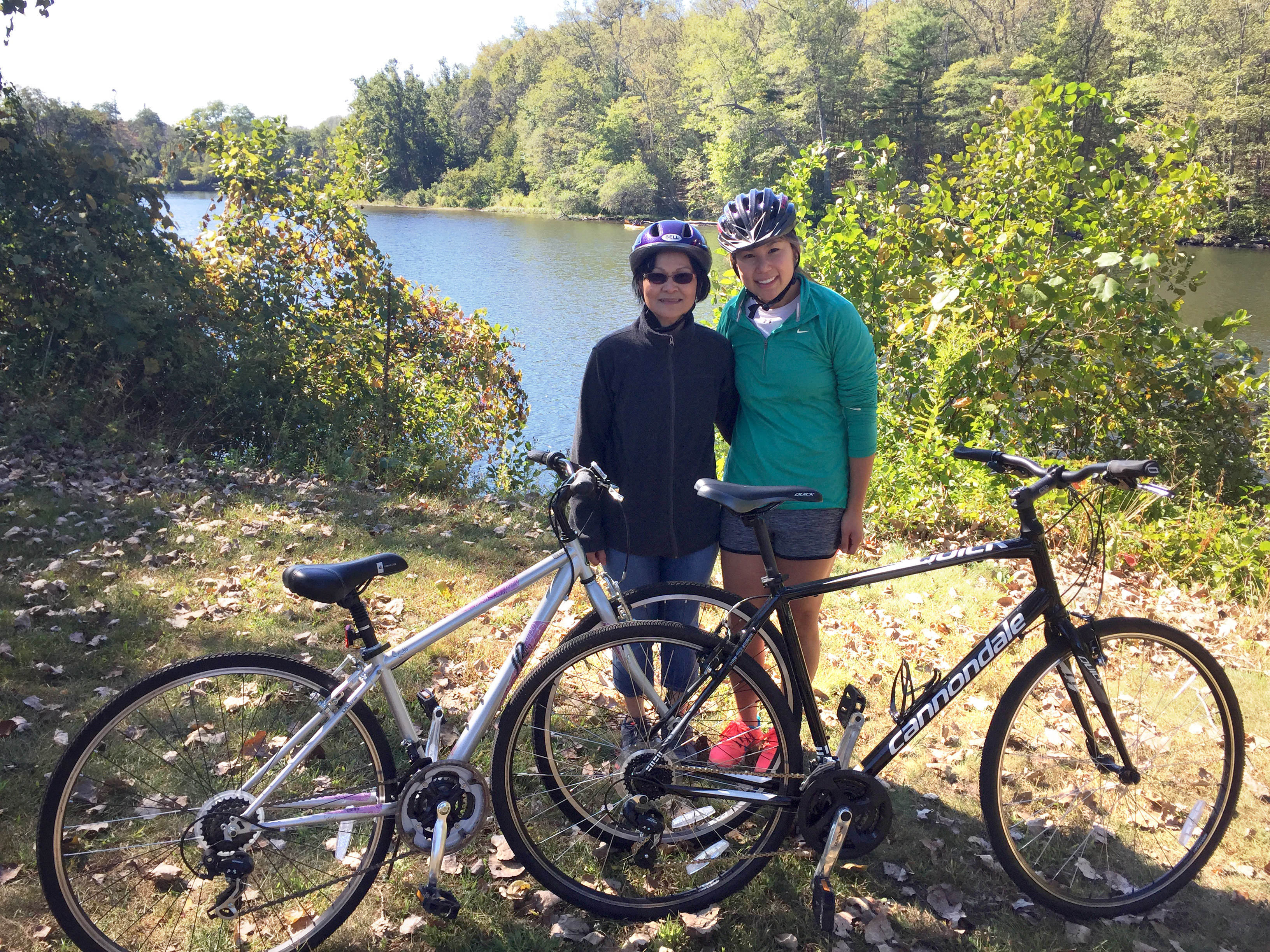 "Then pharmacy graduate student Celeste Cheung '18 Pharm.D. (right) during a 20-mile bike ride along the Farmington River last year with her patient, friend, and ""Cambodian mom"" Lila Plawecki."