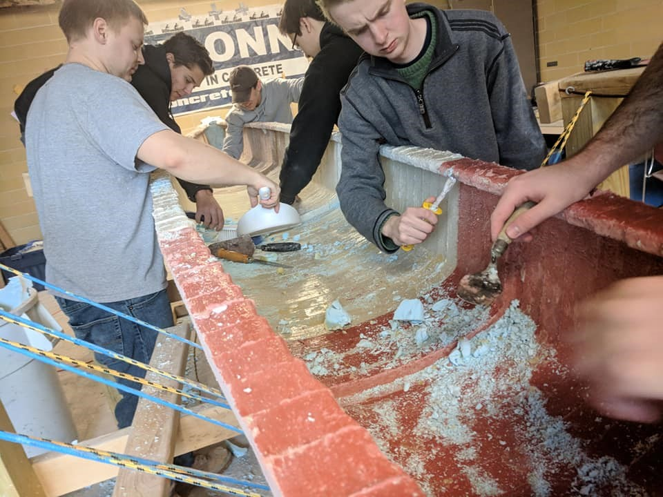 making concrete canoe chipping off plaster
