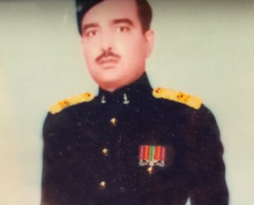 Manisha's father in his younger years dressed in military garb