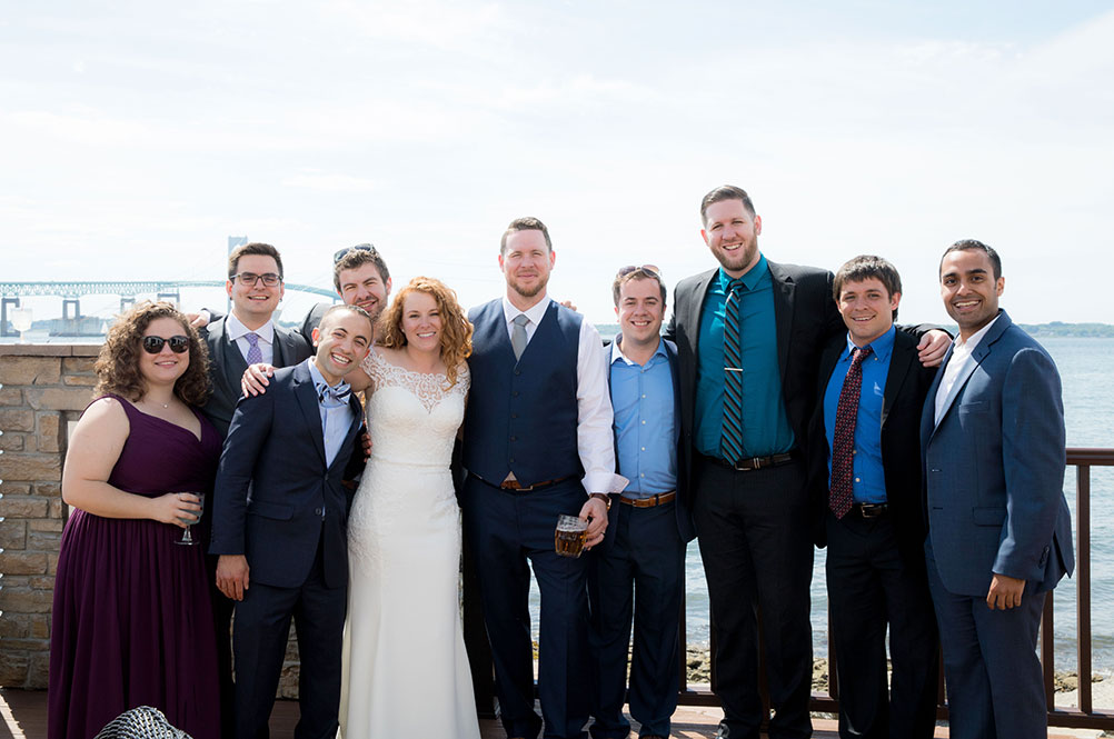 Assistant band director Jessica VonVillas '12 (SFA), '16 MM with new husband Josh Dickerson and band alums in Newport, Rhode Island.