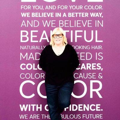 Amy Errett in front of salon poster