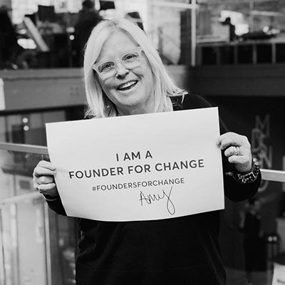 Amy Errett holding a Founder for Change poster