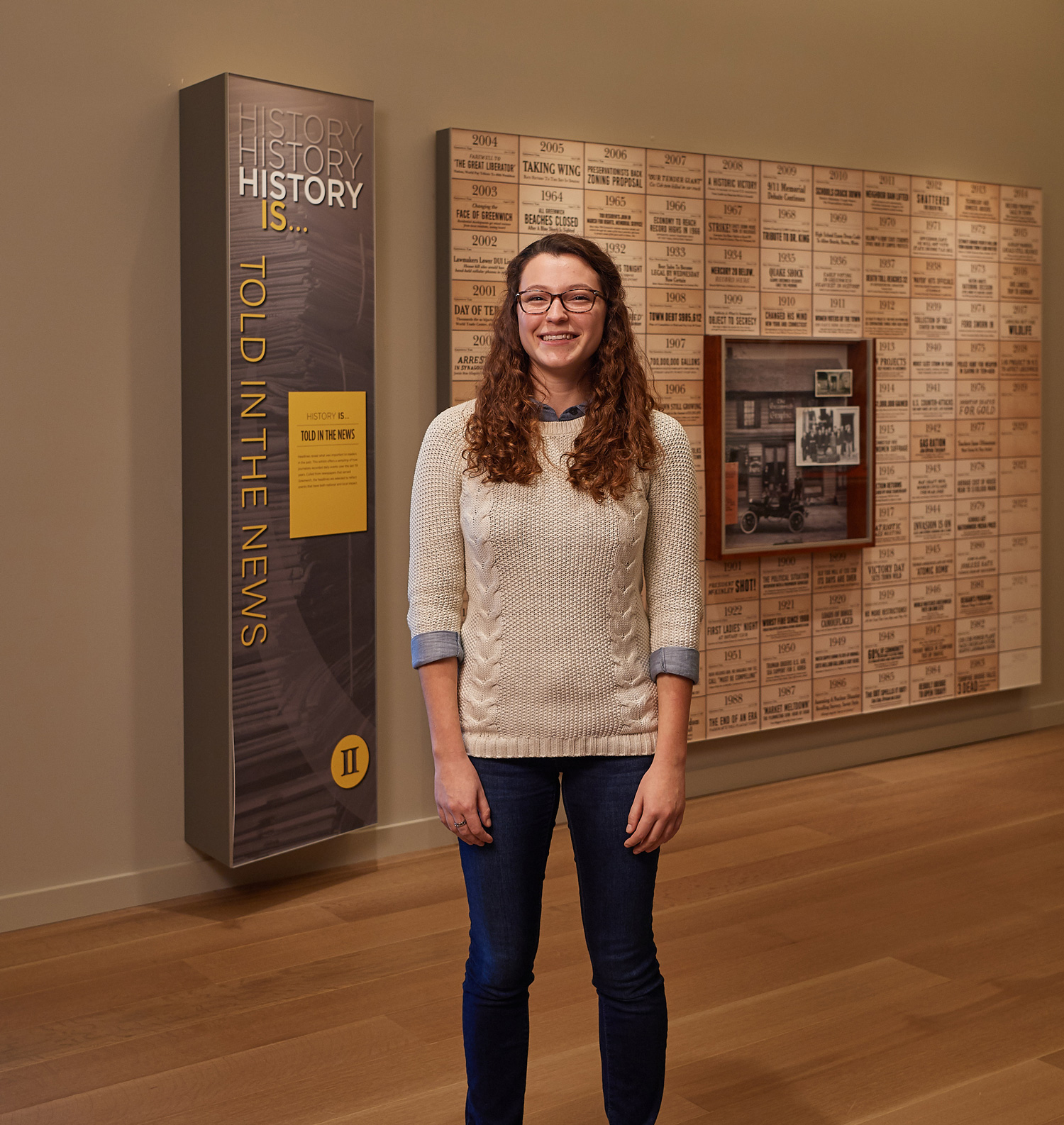 Isabella Ferrante stands near an exhibit at the Greenwich Historical Society