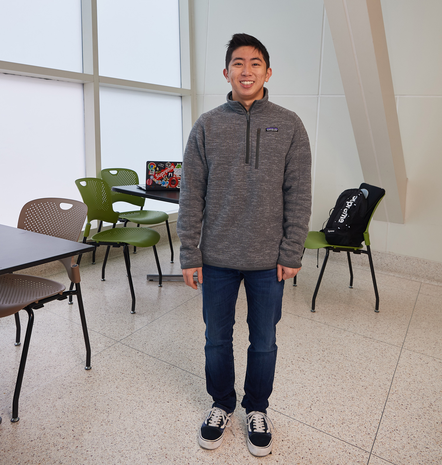 Charles Ira stands in the atrium of the Stamford campus