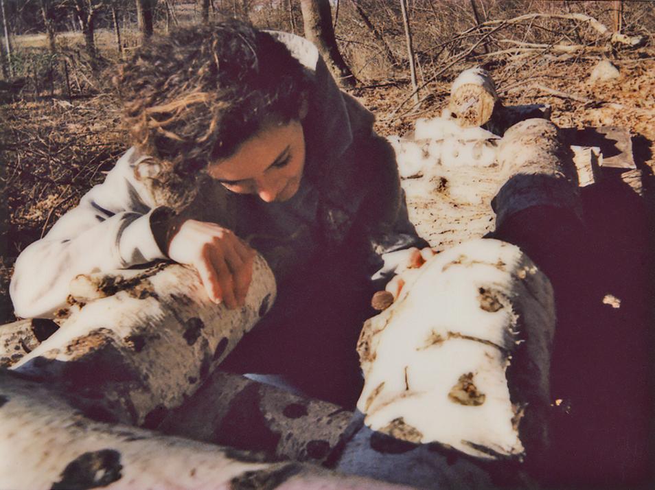 woman inspects mushroom species