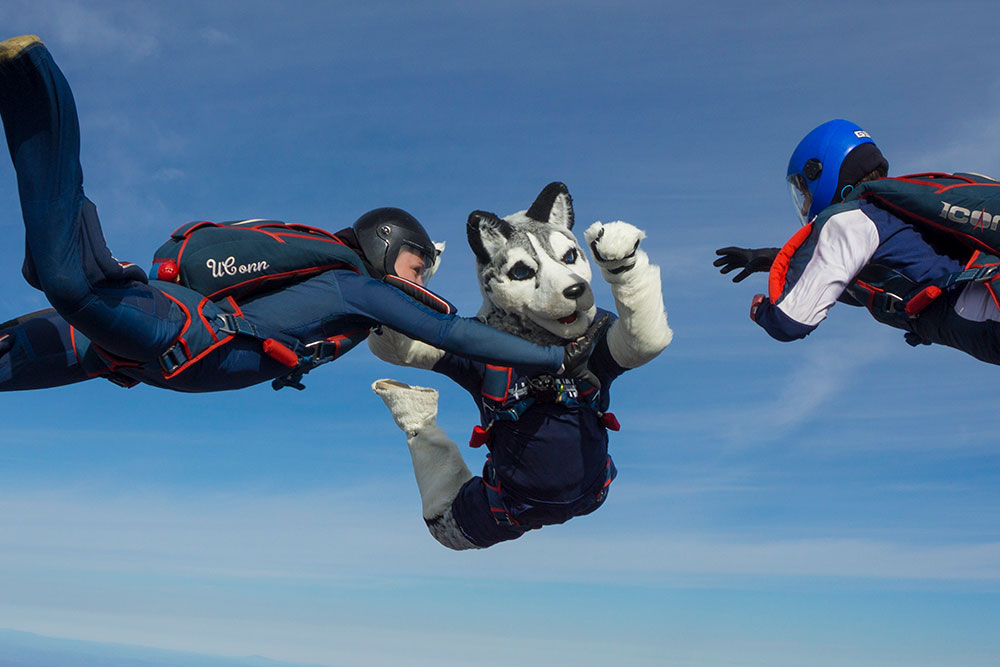 Jonathan, the husky dog (mascot), jumps from a plane during a skydiving exercise