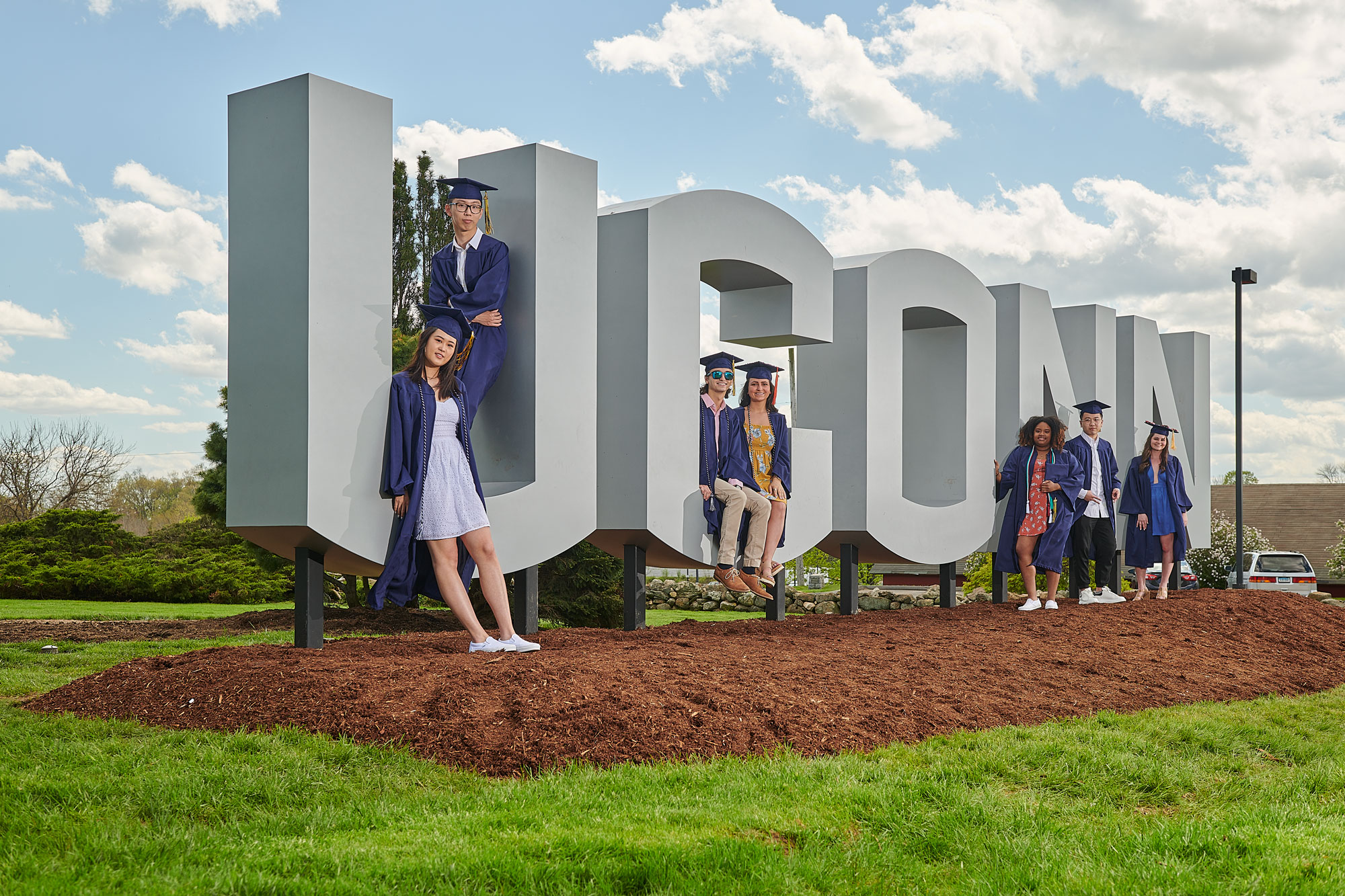 Soon to be graduats pose with the new UConn sign  along RT. 195 near W lot on May 8, 2019. From left are Kailin Lu '19 (CLAS), Kai Lu '19 (CLAS), Harun Malik '19 (CLAS), Carley Corbo '19 (ENG), Sidayah Dawson '19 (CLAS), Zhenhao Zhang '19 (CLAS), and Debra Peel '19 (CAHNR).