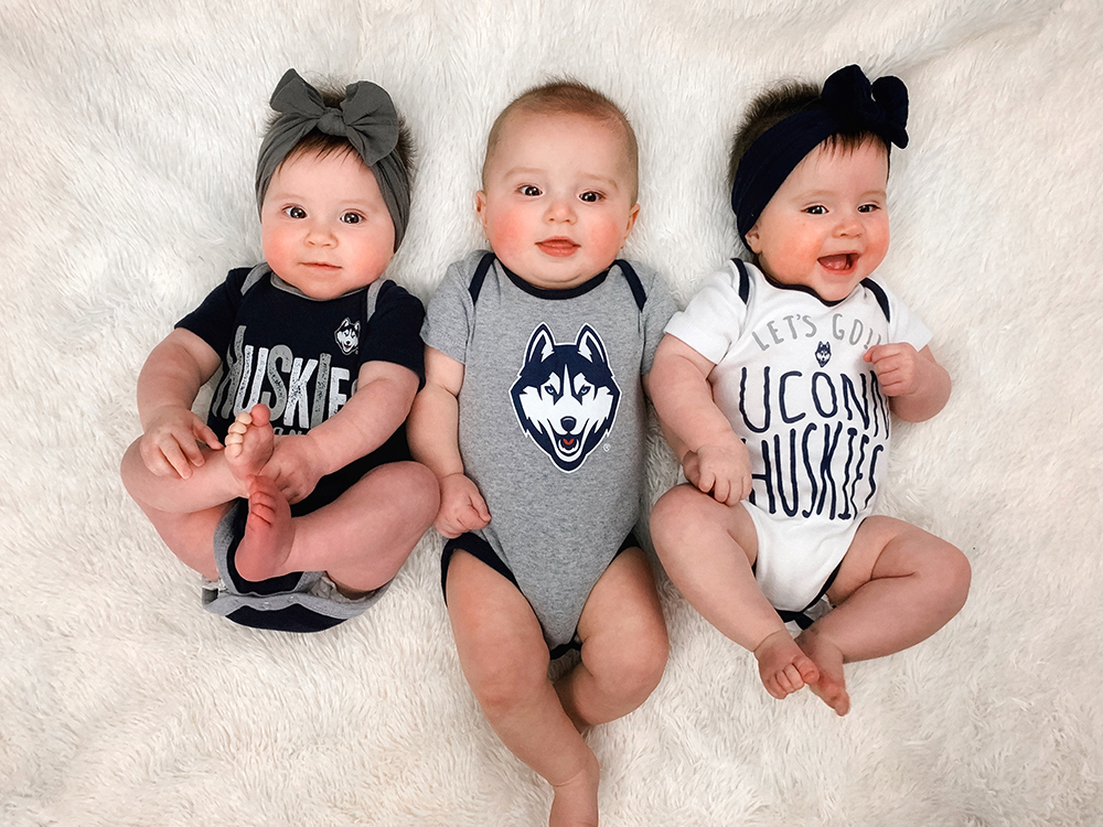 cute triplets decked out in UConn themed baby gear