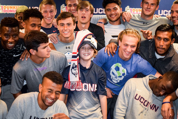 Maddox with the UConn men's soccer team
