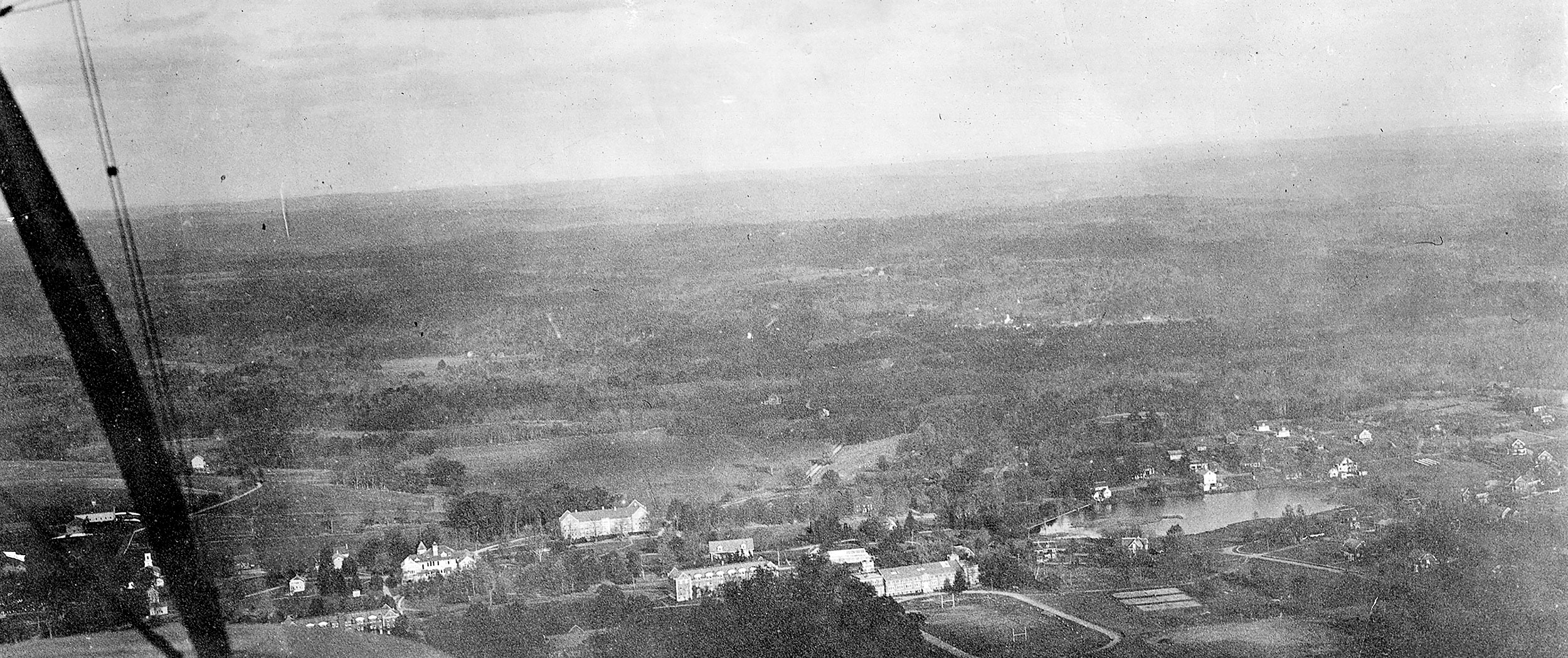 1925 aerial biplane photograph shows Mirror Lake to the right and Horsebarn Hill to the left.