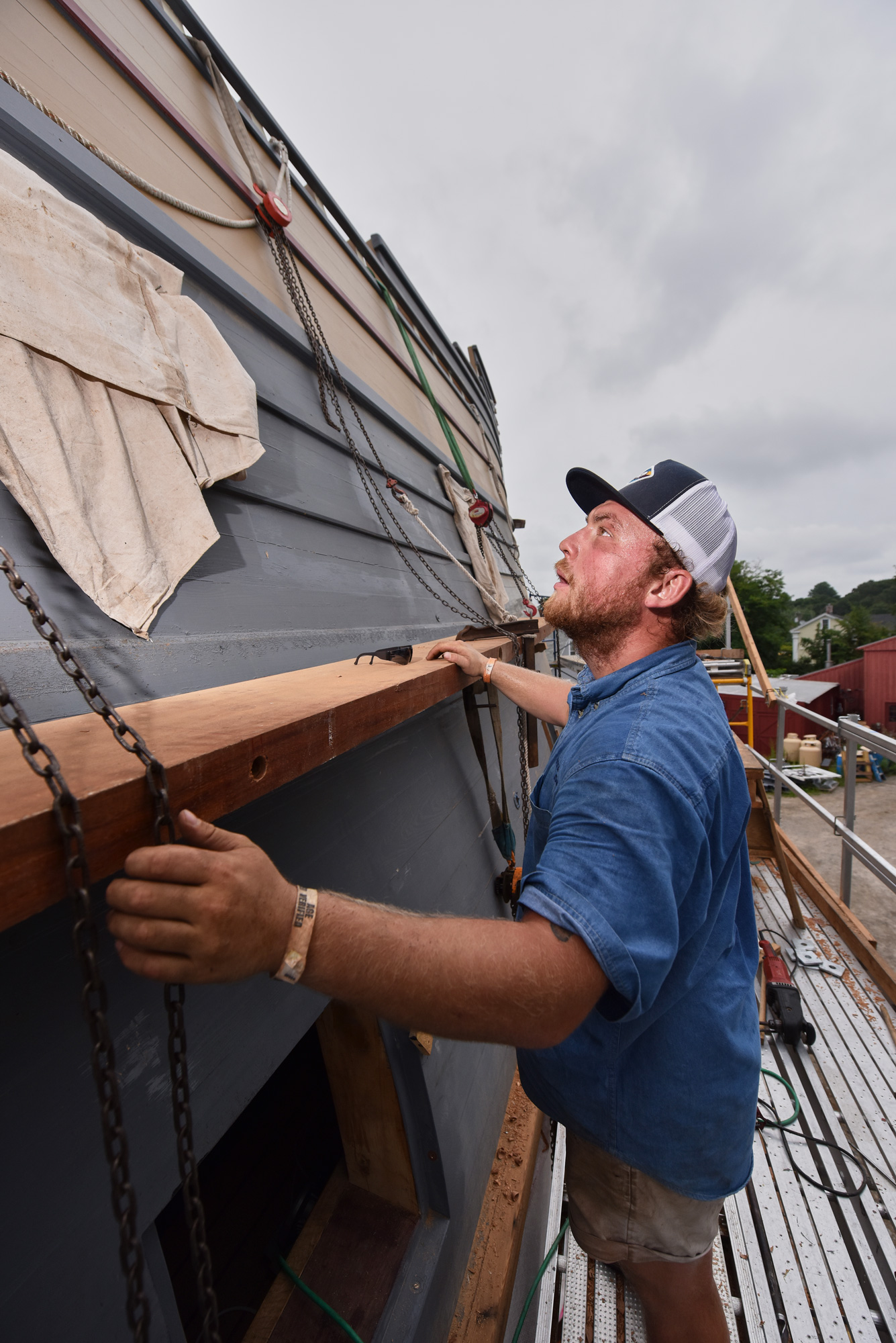 Casey Cochran '15 (CLAS) works on renovations to the Mayflower II at Mystic Seaport