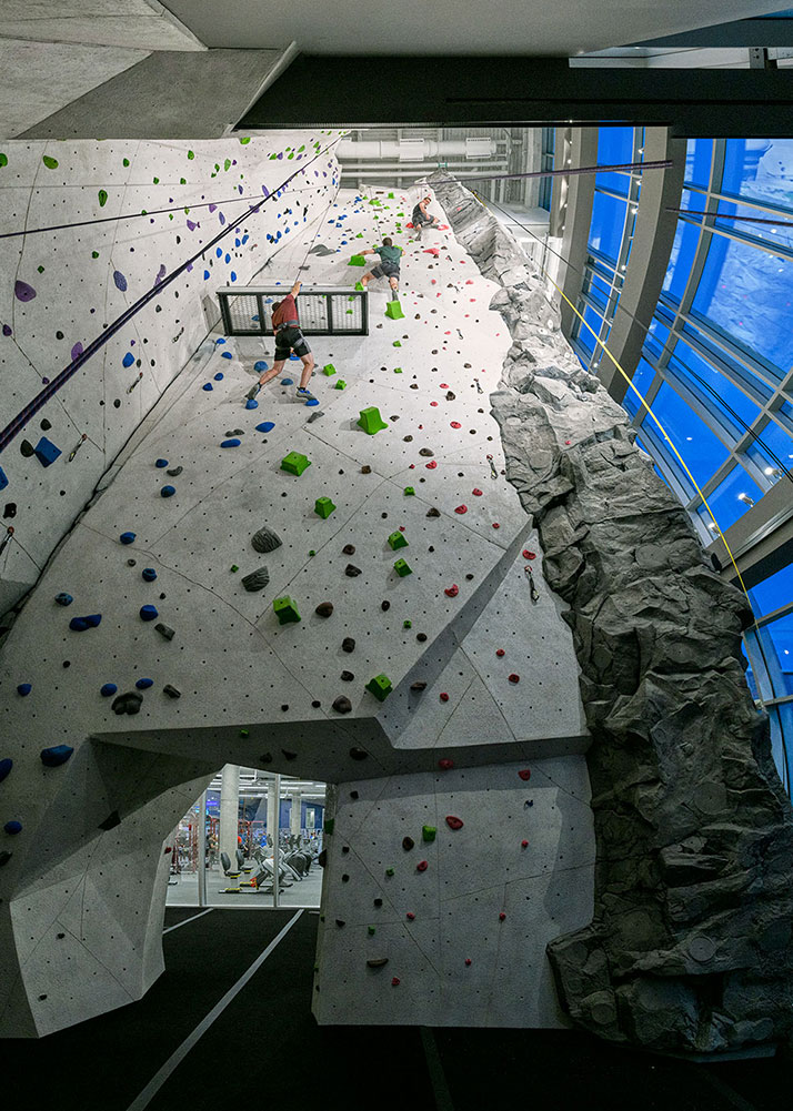 Multistory UConn Rec Center Rock wall surrounded by multisotry windows with campus views