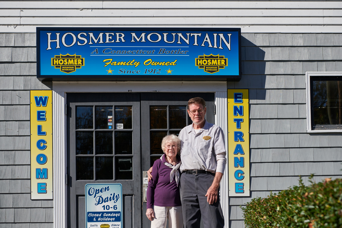 Bill Potvin '67 (CAHNR) with his mother at the Hosmer Mountain Bottling Company in retail store in Willimantic