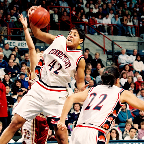 UConn's Nykesha Sales rebounds during a game against Boston College, Storrs CT 1996.