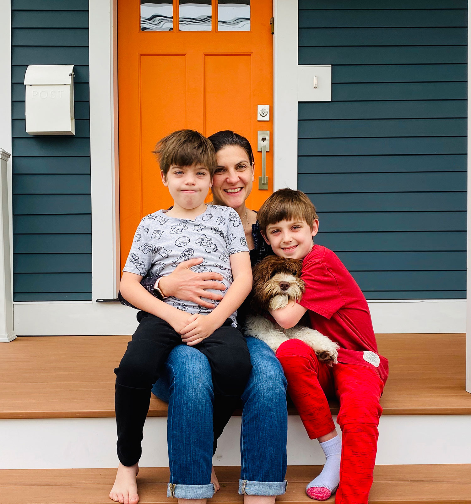 Jennie Weiner, associate professor of educational leadership in the Neag School, at home with her 8-year-old twins Manny and Rufus and their dog Junior.
